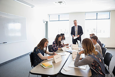Teacher and middle school students in debate club classroom - p1192m1473291 by Hero Images
