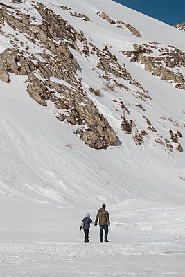 Father and Son Hike up Mountain - p1262m1110476 by Maryanne Gobble