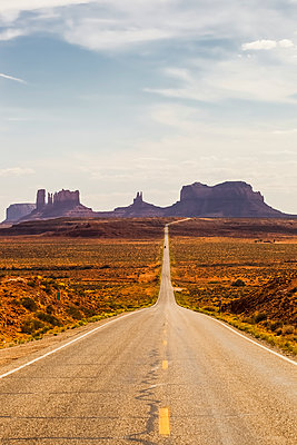 A road leading to rugged rock formations in the desert; Arizona, United States of America - p442m1449029 by Christine Mariner