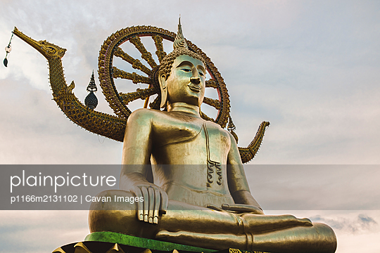Large Golden Buddha Statue at Dusk in Thailand - p1166m2131102 by Cavan Images