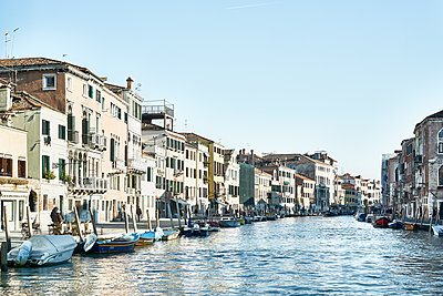 Row of houses and boats along the canal in Venice - p1312m2082225 by Axel Killian
