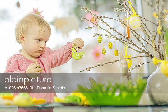Young Girl Hanging Easter Decorations, Osijek, Croatia, Europe