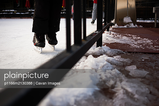 Child ice skating at Beaver Creek Ski Resort in Colorado - p1166m2130388 by Cavan Images