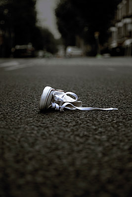 Shoe on Suburban Road - p1248m2125847 by miguel sobreira