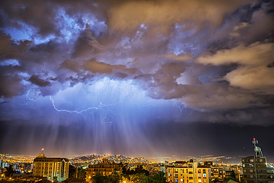 Lightning lights up the night skies above the city of Cochabamba; Cochabamba, Bolivia - p442m1085166f by Robert Postma