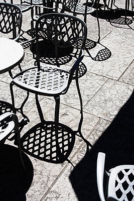 Table and chairs on outdoor terrace - p526m852350 by Stuart Paton