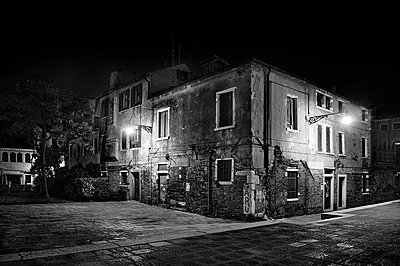 Decrepit building at night - p3314009 by Thomas Ortolan