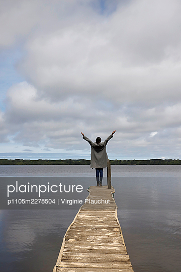 Woman at the lake Leon - p1105m2278504 by Virginie Plauchut