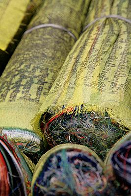 Rolls of prayer flags - p1072m874843 by Michael Steel