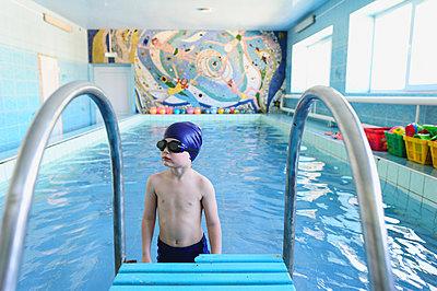 The boy learn to swim in the indoor pool - p1412m1488267 by Svetlana Shemeleva