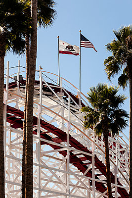 California State Flag and American Flag above roller coaster - p1094m971530 by Patrick Strattner