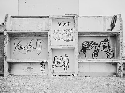 Man in a demolition building with graffiti - p1267m2090167 by Wolf Meier