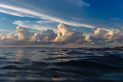 Large clouds over ocean waters at dawn, Male, Maldives - p343m2025616 by Konstantin Trubavin