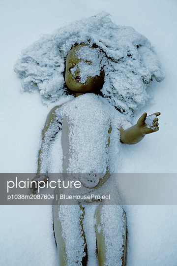 Doll in snow - p1038m2087604 by BlueHouseProject