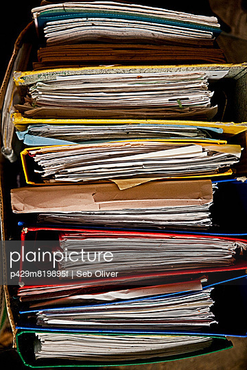 Still life of cardboard box full of files and paperwork