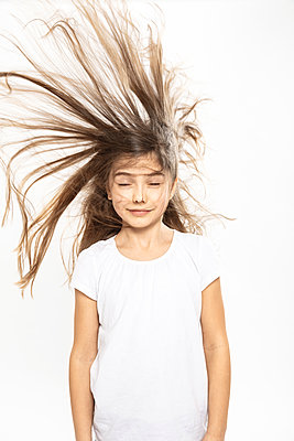Girl with flying hair, white background - p429m2145700 by Matelly