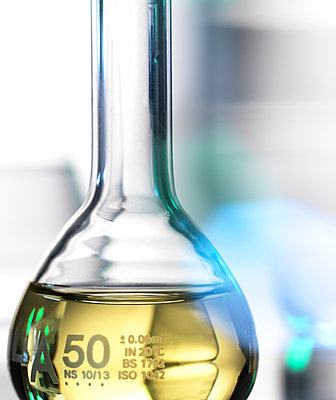 Laboratory beaker containing chemical formula - p429m2050968 by Andrew Brookes