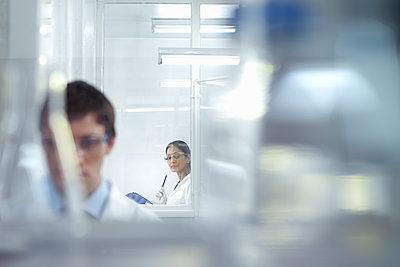 Male and female scientist researchers in research laboratory. - p429m2200751 by Monty Rakusen