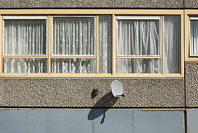 Windows of flat on Heygate Estate, South London - p9245067f by Image Source