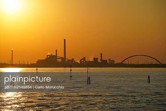 Industrial chemical area of Marghera seen from the ferry, Venice lagoon, Venice, Veneto, Italy - p871m2149854 by Carlo Morucchio