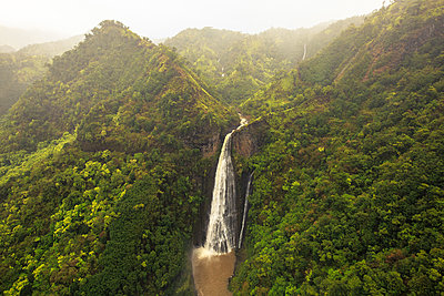Manawaiopuna Falls on Kauai, Hawaii is also known as Jurassic Park Falls and was made famous by the movie Jurassic Park. - p343m1217990 by Matt Andrew