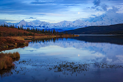 Moonrise over the Alaska Mountain Range with Denali on the right and Brooks on the left, and Wonder Lake in the foreground, Denali National Park and Preserve, Interior Alaska; Alaska, United States of America - p442m2058099 by Steve Zmak