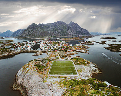 Football field on peninsula, Henningsvaer, Norway - p1549m2245171 by Sam Green