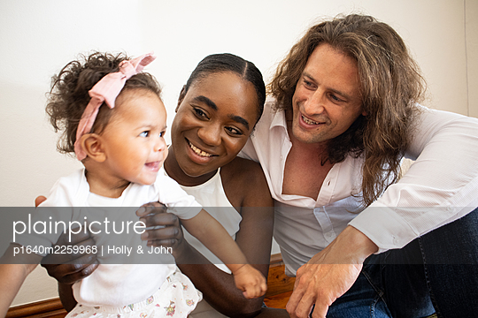 Multi ethnic family with toddler girl - p1640m2259968 by Holly & John