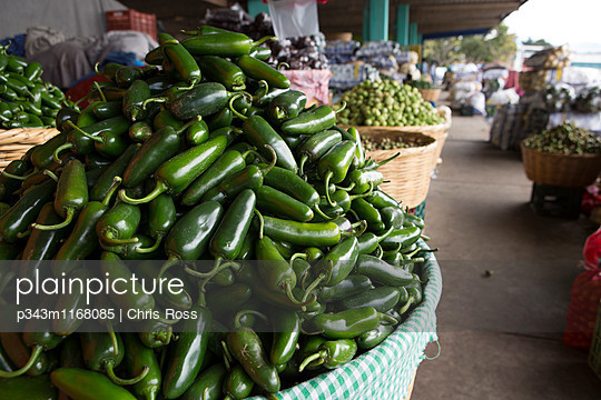 A closeup view of a basket of green chili peppers. - p343m1168085 by Chris Ross