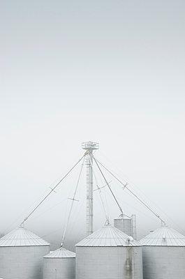 Silos in fog - p1427m2254886 by Chris Hackett