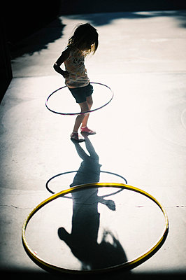 Young Girl with Hula Hoop - p694m1014827 by Kristianne Riddle