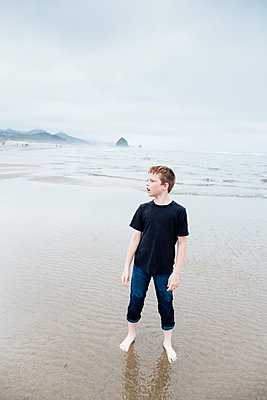 Boy at Cannon Beach - p1262m1440873 by Maryanne Gobble