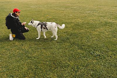 Man with dog - p312m2139873 by Stina GrŠnfors