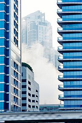 Steam between skyscrapers - p312m1024554f by Magnus Ragnvid