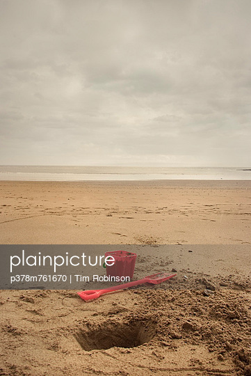 Bucket and spade - p378m761670 by Tim Robinson