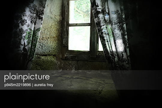 Old stone house with lattice window - p945m2219896 by aurelia frey