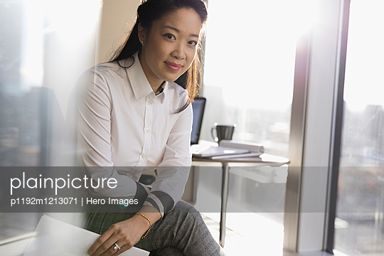 Portrait confident female lawyer in office