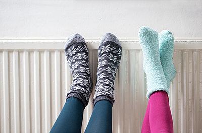 Warming feet on the radiator - p1231m2055681 by Iris Loonen