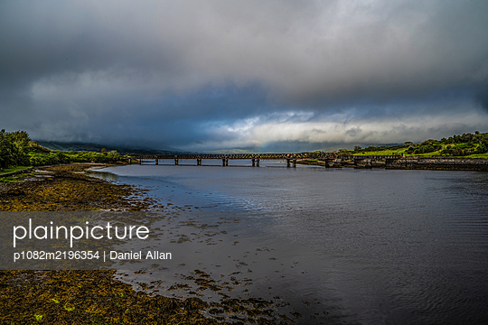 Abandoned old bridge and thunderclouds - p1082m2196354 by Daniel Allan