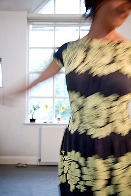 Woman dancing in front of window - p3882188 by Andre