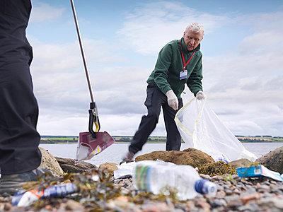 Environmentalist cleaning up beach - p42917314f by Monty Rakusen