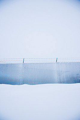 Snow covered fence - p4423441f by Design Pics