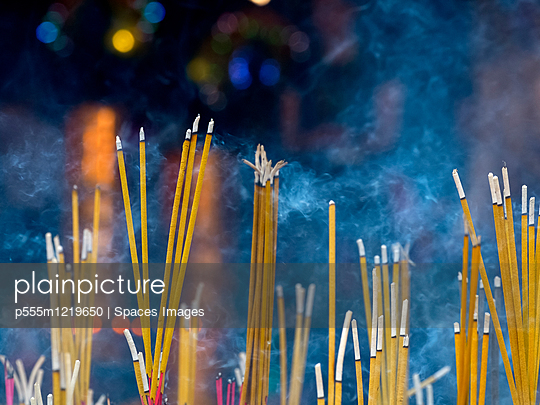 Close up of incense sticks burning