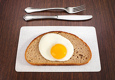 Fried egg on a slice of bread - p4735779f by STOCK4B-RF