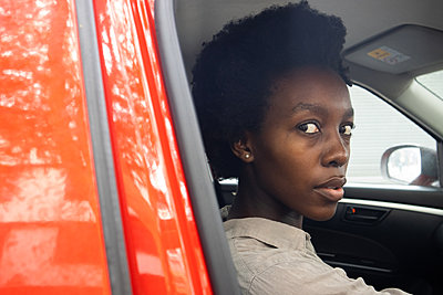 Young African woman in a car - p1640m2260077 by Holly & John