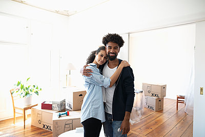 Portrait affectionate, confident couple moving into new home - p1192m2016729 by Hero Images