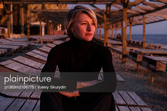 Woman on beach  - p1363m2108775 by Valery Skurydin