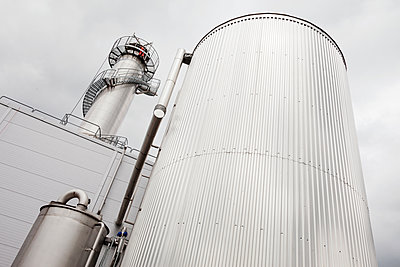 Low angle view of grey silo - p312m1549190 by Scandinav Images