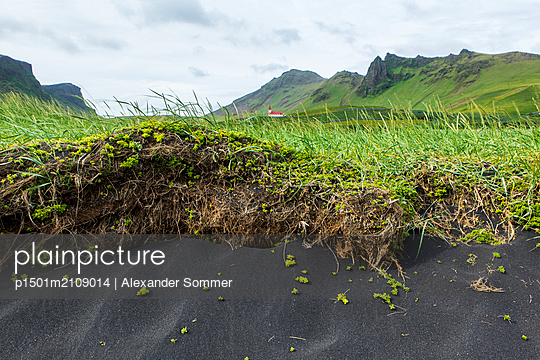 Black sand beach and church, Iceland  - p1501m2109014 by Alexander Sommer