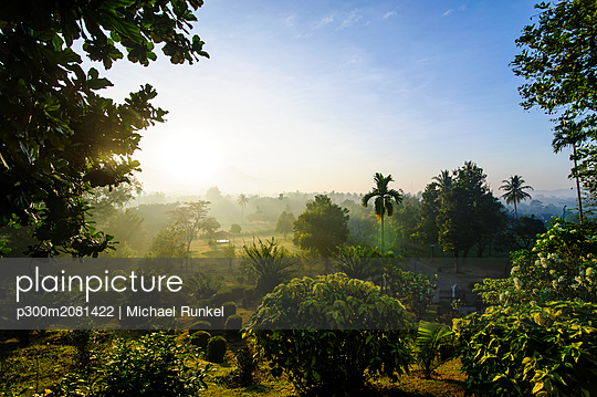 Indonesia, Java, early morning view from the Borobudur Temple Complex on the scenery around - p300m2081422 by Michael Runkel